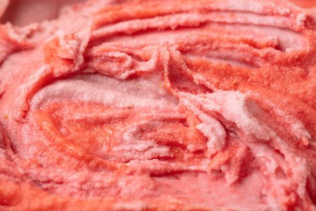 Texture of strawberry ice cream from above as red background