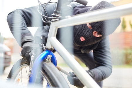 Bicycle thief on bicycle steal in the city Stock Photo - 123034379