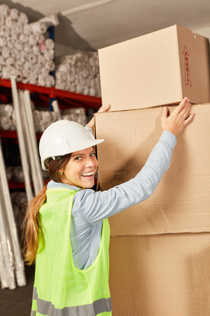 Woman as a warehouse worker in online trade. Delivery service with a stack of packages