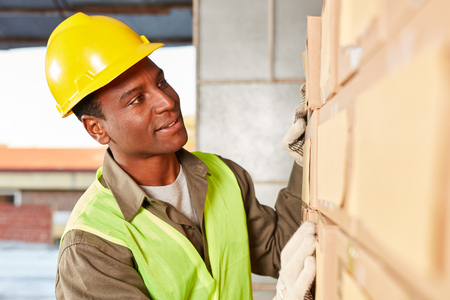 Warehousing specialist in the online shopping center is looking for a package in the warehouse
