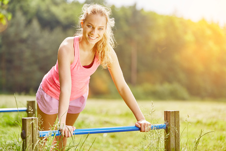 Young woman training in the park to stay fit