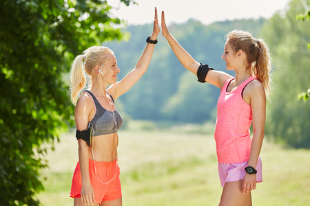 Young women giving each other a High Five as motivation