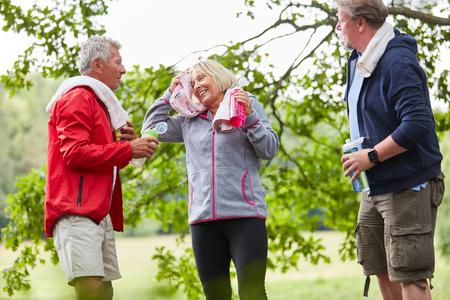 Seniors take a break on a trip or a hike