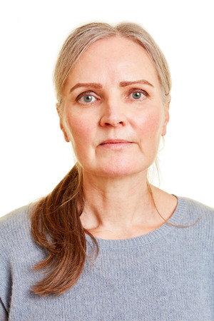 Frontal face of an old serious woman
