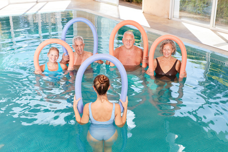 Senior group in a course for aquagym in back training