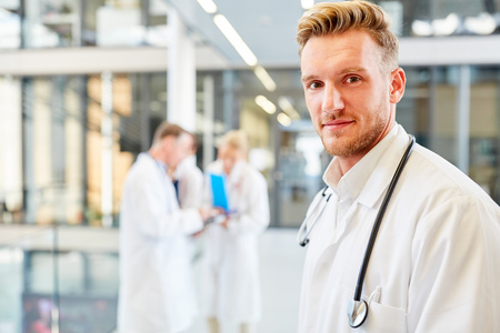 Young man as a competent medical assistant or medicine student in the hospital