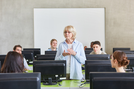 Senior as lecturer in university computer course lessons