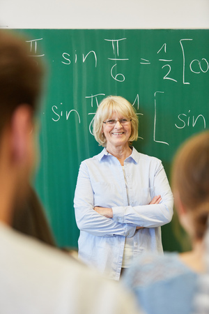 Senior woman as successful teacher or lecturer at university