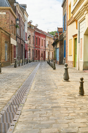 Narrow alley in colorful old town in Amiens, France at the day