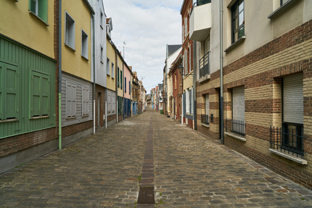 Narrow straight empty street in the old town of Amiens, France