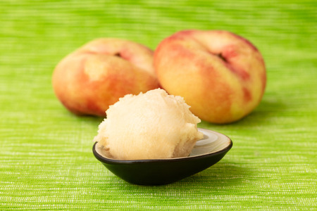 Fresh homemade scoop peach sorbet made from flat peaches