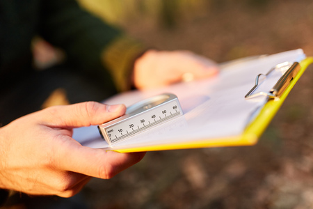Measuring instrument for determining the tree height and checklist of the forester