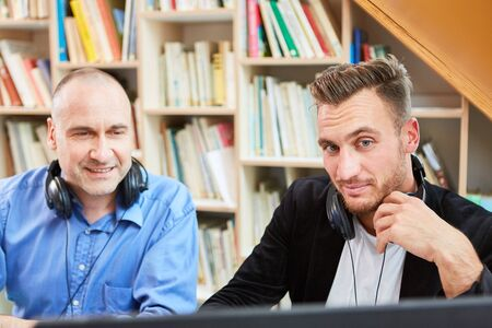 Two freelancers as competent software developers work together on the computer