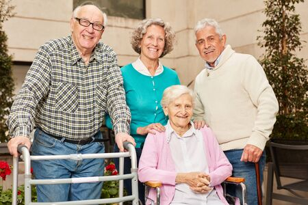 Group seniors as friends and pensioners in retirement home or retirement home