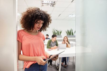 Young African business woman as an intern or trainee in coworking office
