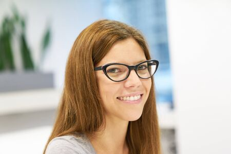 Young sympathetic woman as a student or beginner in university or business