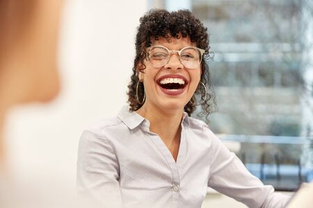 Laughing young business woman as dynamic young talent or student