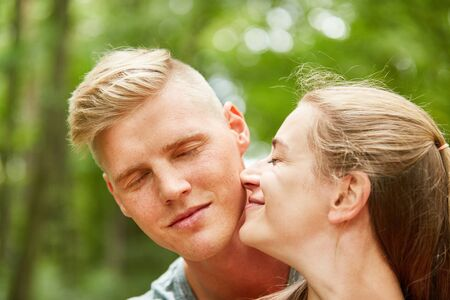 Happy woman leans affectionately and in love with her partner