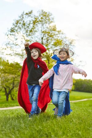 Boy and girl in fantasy costumes at the carnival or a kids birthday