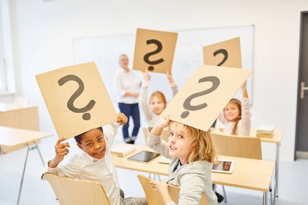 Children in elementary school keep question mark for problem and doubt