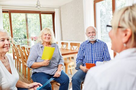 Group of seniors with therapist in a psychotherapy session at retirement home