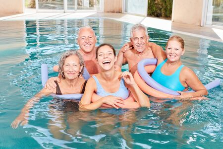Vitale group seniors in the swimming pool is doing water aerobics rehab course