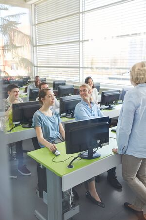 Students learn in computer course at university or college