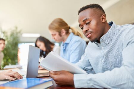 Man as african student in language course in university
