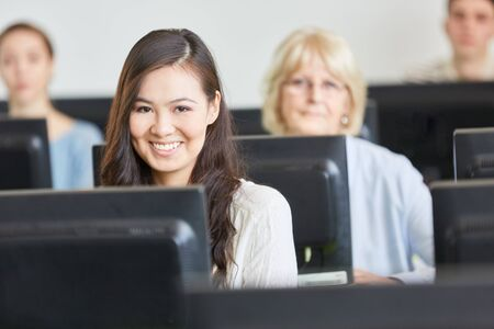 Asian woman as IT student in computer course Stock fotó