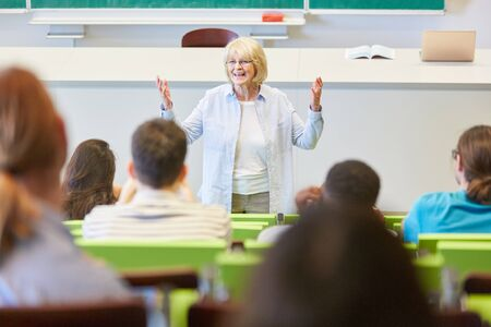 Woman as lecturer teaches students class in university