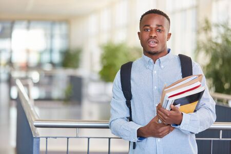 African student with text books in university