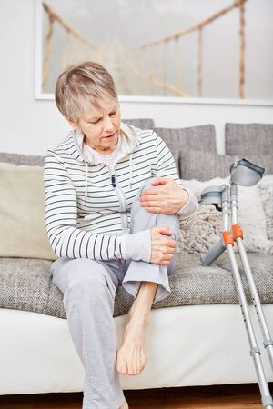 Senior woman with injury has pain on her knee