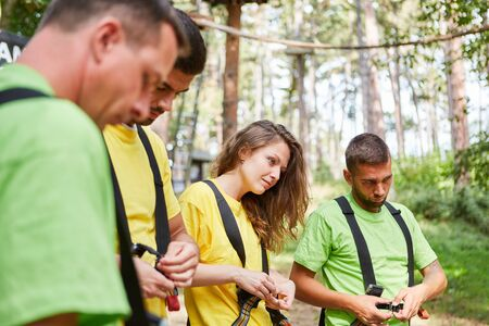 In the climbing forest, beginners receive training in a climbing course Stock fotó