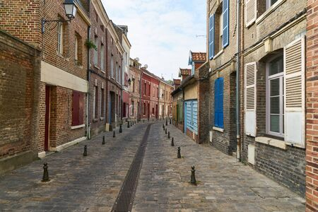 Many old houses beside alley in the old town of Amiens, France