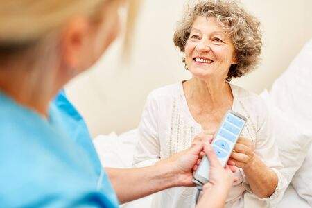 Old woman and nursing help together in nursing home or at home care