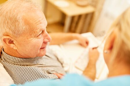 Nursing Ms. cares for a senior man in home care