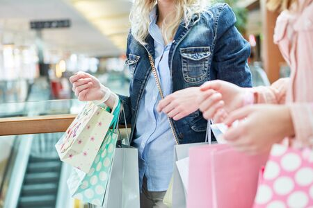 Women shopping at retail as a sign of consumerism and lifestyle
