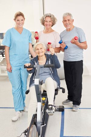 Group of seniors in the fitness center is training with trainer in a rehab course