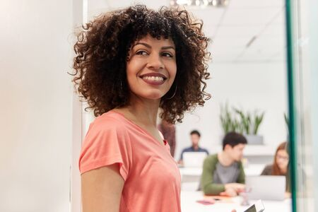 Young african businesswoman as apprentice or intern in coworking office Stock Photo