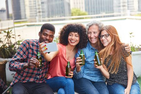 Friends drinking beer during their free time take a selfie with their smartphone Stok Fotoğraf