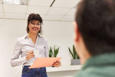 Young business woman with a document during a job interview in the office
