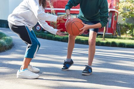 Children play basketball at the summer camp or at the school playground