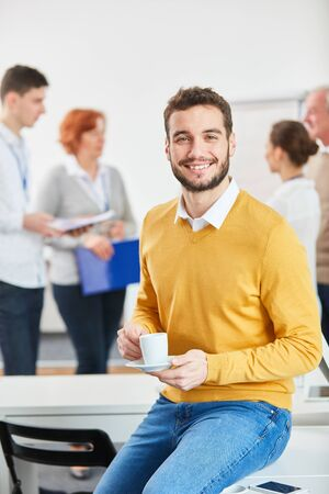 Young man as start-up entrepreneur in his coffee break