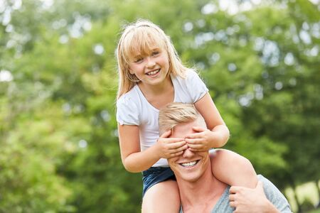 Blonde girl is watching her father and having fun Stock fotó