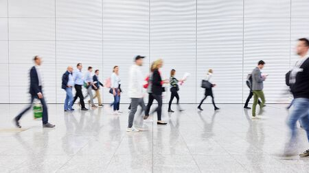 Anonymous crowd people walks in a trade fair hall Stock Photo