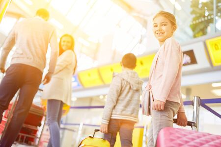 Family is vacationing on childrens vacation with air travel at the airport Zdjęcie Seryjne