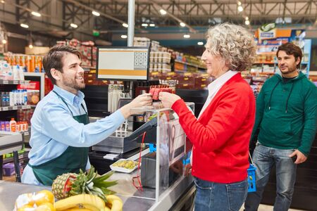 Customer pays by cashier or customer card at cashier supermarket checkout Stock fotó