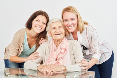 Happy family with granddaughter and grandmother make home care together