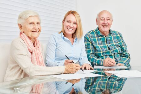 Senior couple with contract from consultant on home finances