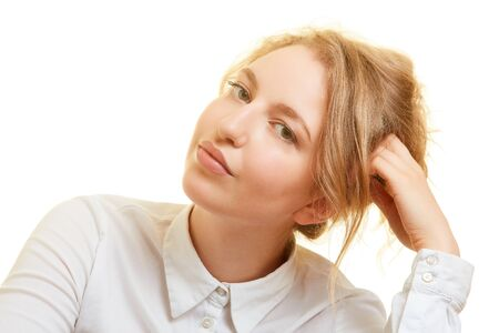 Thoughtful young blond woman is looking for a solution to her problem Imagens